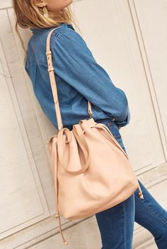 madewell drawstring transport tote worn with the embroidered cutoff denim shirt + cali demi-boot jeans.