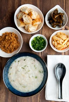 congee with pork sung, sliced chinese doughnut, chinese pickled cucumber, chili bamboo shoots, green onions