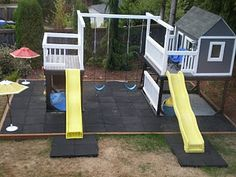 Incredible Playset/swingset. Completely finished playroom inside house! Love the separate slides and little decks! Esp. love the rubber floors...would love this one day...