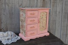 Tall upcycled vintage jewelry armoire and music box. Wood, hand painted in soft blush peach with decoupage in toile and flowers, and lightly distressed with a protective clear coat. The door is decoup
