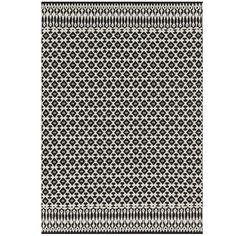 Part of the Magnolia Home Collection by Joanna Gaines, the Emmie Kay Rug delivers bold energy to any room. Hand-woven of 100% wool, it features a traditional design in classic black and white. Plus, it looks great under any number of Pier 1 pieces!