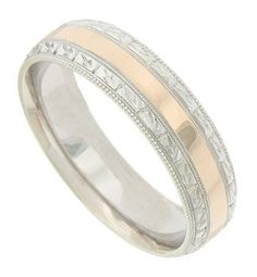 This 14K bi-color mens wedding band features a wide smooth polished red gold central band. The edges of the ring are crafted of white gold, edged in milgrain and decorated with deeply engraved organic designs. The antique style wedding ring measures 6.09 mm in width. Size 10 1/4. We cannot re-size, but we can reorder in other sizes. Also available in 18K, yellow gold, platinum and palladium. Contact us for current market cost.
