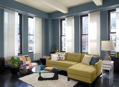 Blue and white modern urban living room. Walls Philipsburg Blue, ceiling Lancaster Whitewash, accent Princeton Gold
