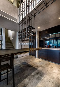 Monoform Living project is a loft apartment turned into a living piece of art made from steel rods by PRODUCE Workshop, located in Novena, Singapore. Cafe Interior, Kitchen Interior, Interior And Exterior, Interior Design, Steel Cage, Steel Rod, Wine Shelves, Metal Shelves, Appartement Design
