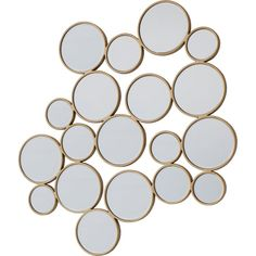 A statement contemporary round mirror design surrounded by a soft gold protruding frame.