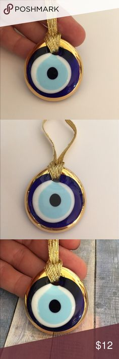 🆕 Turkish Evil Eye Amulet 🆕 From Turkey 🌟 Nice Blue Glass With Gold Evil Eye Protection Amulet with Card. Gold Elastic Cord to hang from Car Mirror, etc. makes a Great Gift. Bundle and save. Only have two of these Accessories