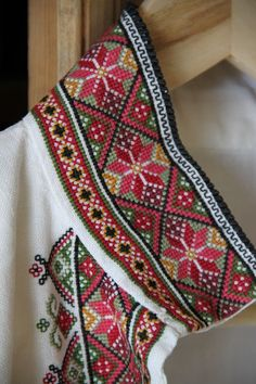 """bunadskjorte - Norwegian """"bunad"""" shirt with fine cross stitch detail. A traditional pattern you see in sweaters, mittens, paintings etc. Cross Stitch Pillow, Cross Stitch Borders, Cross Stitch Flowers, Cross Stitch Designs, Cross Stitching, Cross Stitch Patterns, Folk Embroidery, Embroidery Fashion, Cross Stitch Embroidery"""