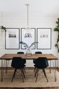 black and white dining room // woven rug // shiplap walls // glass globe pendant light #HomeDecor