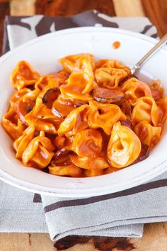 Cheesy Sausage Tortellini Recipe. SO GOOD! One dish, and done in 30 mins or less. www.kevinandamanda.com