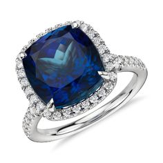 The perfect complement to a cocktail! This gemstone ring showcases a vibrant cushion-cut tanzanite surrounded by micropavé-set diamonds.