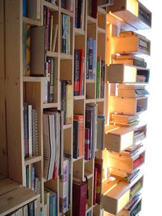Use pallets to make these vertical book shelves maybe in the basement