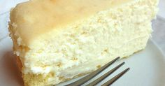 A tall, dense, rich cheesecake with a vanilla sponge cake crust.