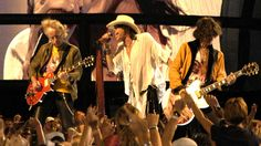 Brad Whitford, Steven Tyler, and Joe Perry of Aerosmith performing at the NFL Kickoff in Washington DC on September 4, 2003