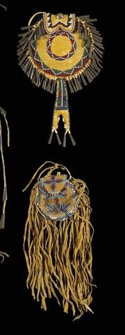 Two Apache beaded pouches. Both circular and partially beaded on the front, one ringed with tin cones and trailing a split tab, the other decorated with lengthy fringe and ochre pigment all over.  length 8 ½ and 9 1/4in  Property from the Estate of Lynn Trusdell, New Hope, PA        (TWQQ - 12/8/08)