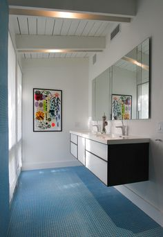 Another one of the home's light-filled spaces, the bathroom includes Wetstyle sinks and blue tiling. Photo courtesy of the owners.