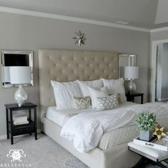 Pottery Barn Tall Lorraine Tufted Bed with white bedding