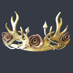 Game of Thrones Margaery Tyell's wedding tiara was crafted in the same way as Joffery's crown, with the addition of copper roses. The roses were created using copper clay, hand rolling and presing each petal into shape and slowly building up the petal layers to form the rose.