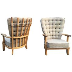 Guillerme et Chambron, Pair of Grand Repos Oak Armchairs Edition Votre Maison | From a unique collection of antique and modern armchairs at https://www.1stdibs.com/furniture/seating/armchairs/