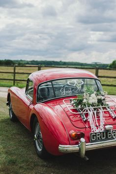 Image by KRAAN Wedding Photography. - An English Back Garden Wedding With A Romona Keveza Dress And Jimmy Choos And A Pink Rose Bouquet With Mint Bridesmaid Dresses By KRAAN Wedding Photography.