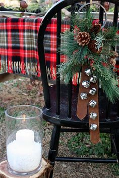 Adorable Christmas decor idea for chairs. Love the plaid tablecloth as well. Love to try this.
