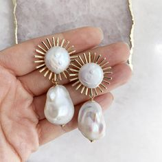 Our best selling Astrid Earrings are now available with a gorgeous baroque pearl drop! 14k gold plated post and details. Measures 2 inches long and .75 inches wide. Pearl Necklace Designs, Pearl Jewelry, Beaded Jewelry, Jewlery, Bulgari Jewelry, Punk Jewelry, Hippie Jewelry, Trendy Jewelry, Women's Jewelry