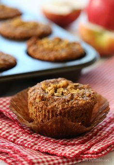 Whole grain apple muffins made with fresh apples, walnuts with a granola topping.