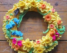 springtime wreath, with daffodils, bluebells, butterflies and a fluffy bumble bee