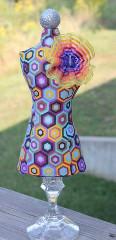DIY mannequin pincushion, hexagon pattern and yellow and purple ribbon flower with butterfly button. Made 2013