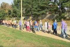 People walked a one mile loop around Harrison High School to raise awareness of Multiple Sclerosis Sunday.