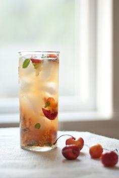 Rainier Cherry Mojito    1.5 oz white rum (Myer's is my favorite)  8 cherries  small handful fresh mint leaves  juice of 1/2 a lime  1 teaspoon raw (turbinado) sugar  club soda