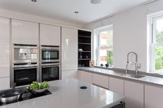Nolte handleless Mocha Veneer and Glass-Tec Sahara kitchen with island