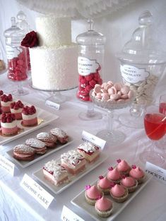 Pink, red, and white wedding dessert table #wedding #weddingdessert #desserttable #pink #red