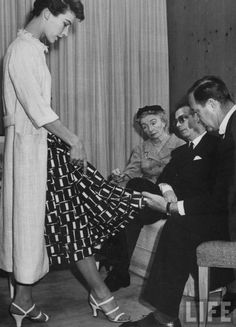 Cristobal Balenciaga, 1952. To the left of Balenciaga sits Carmel Snow, Bazaar's Editor in Chief.