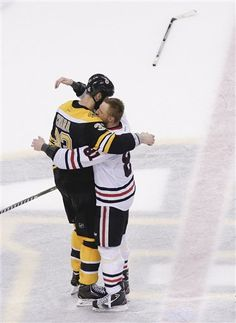 Boston Bruins defenseman Zdeno Chara (33), hugs Chicago Blackhawks right wing Marian Hossa (81), both of Slovakia, after the Blackhawks beat the Bruins 3-2 in Game 6 of the NHL hockey Stanley Cup Finals, Monday, June 24, 2013, in Boston