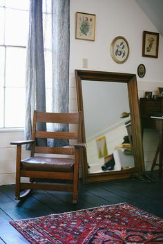 black painted floor Bluebirdbaby, via Flickr- that is the perfect rocking chair. I need one.