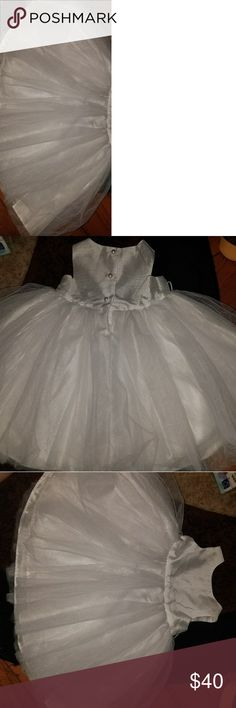 Infant dress all white In perfect condition no stains rips or tares. From a smoke and pet free home.  All white dress silky top and poofy bottom. Dresses Formal