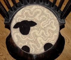a hooked sheep--chair pad