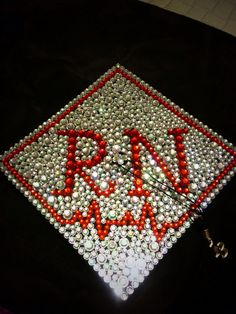 Nursing School RN Graduation Grad Cap. All stones were bought from Hobby Lobby in different sizes (iridescent clear & red) and they were all hand glued with a fabric glue. Great to keep in a shadow box after graduation with your nursing pin & some pictures from the ceremonies!