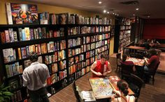 Board games in a coffee shop.  How awesome, reminds me of games in a bookstore I once knew of. ;)