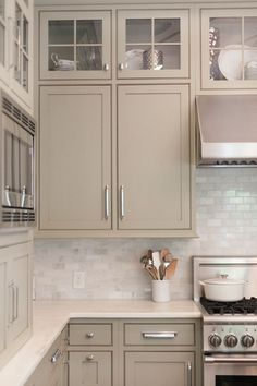 white Kitchen Backsplash. Like the cabinet color too, warmer than white but still light and neutral