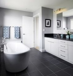 LOVE the charcoal floor tiles matched with the white and grey. I also like the freestanding bath