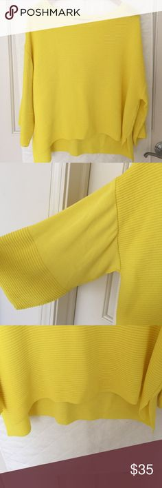 Zara Knit Yellow Top From Zara. It's a knitted material that's heavy with a wide boat neck cut. It's a boxy oversized fit with loose sleeves that are about 3/4 length. The knit material is a cross between knit and neoprene. Never worn. Zara Tops