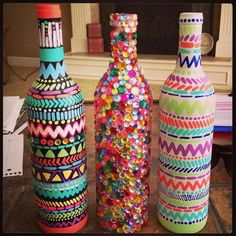 Using paint, jewels, and any other art and craft bits you have lying about design your used wine bottles for a funky look! #DIYHomeDecorCreative