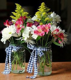 Gingham Scraps Arrangement: This easy-to-make flower arrangement could be your next go-to gift. Just tie a piece of gingham fabric around your Mason jar and add a bouquet. Click through to find more pretty mason jar flower arrangements to try this summer. Mason Jar Flower Arrangements, Mason Jar Flowers, Mason Jar Centerpieces, Flower Centerpieces, Floral Arrangements, Centerpiece Wedding, Kitchen Centerpiece, Flower Vases, Summer Flower Arrangements