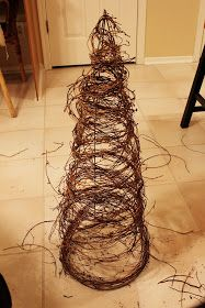 """Grapevine and tomato cage tree. ***one grapevine spiral didn't go very far. I used the smallest tomato cage I could find and still had to cut a 1/3 (largest rings) off to give the desired """"fullness"""", although I'm very happy with the finished result on my sofa table! ***"""