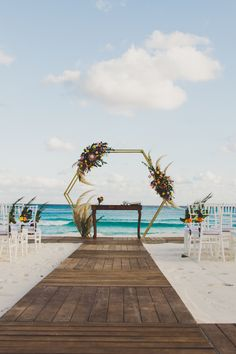 Vickie and Daniel's metallic geometric altar added a modern element to their tropical beach wedding. Click the link for more eye-catching altars!