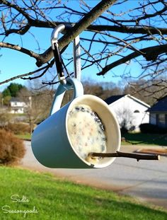 I am totally going to make this in the winter! A DIY suet bird feeder made from a chipped or unwanted coffee mug! Looks super easy and my birds will love it. Fun upcycle craft project and thrift store makeover from #SadieSeasongoods / www.sadieseasongoods.com