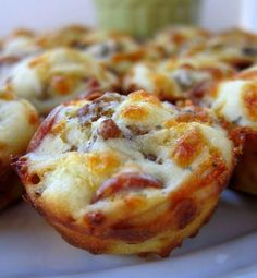 Pizza Puffs 3/4 cup flour 3/4 tsp baking powder 1/2 tsp garlic powder 3/4 cup whole milk 1 egg, lightly beaten 4 oz mozzarella cheese, shredded (about 1 cup) 2 oz mini turkey pepperoni, (about 1/2 cup) 4 oz low-fat sausage, cooked and crumbled 1/2 cup pizza sauce Pre-heat the oven to 375°. Grease a 24-cup mini-muffin pan. In a large bowl, whisk together the flour, garlic powder and baking powder; whisk in the milk and egg. Stir in the mozzarella, sausage and pepperoni; let stand for 10…