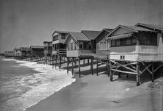 Tides Bring New Peril, Pilings SmashedFromPier,Property Damage Increases as Oceanic Disturbance Pounds Beach Front, Film People Aid Residents in Erecting Barricades Against Rising Seas. Newport Beach, 1930s, Beach House, Ocean, California, Cabin, History, House Styles, Times