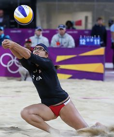 Misty May-Treanor of US reaches for a ball during the Beach Volleyball match against Australia at the 2012 Summer Olympics, Saturday, July 28, 2012, in London.